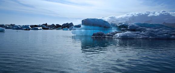 Panoramic view of a beautiful blue iceberg