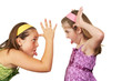 canvas print picture - Two young girls fighting and sticking tout heir tongues out