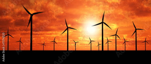 Aluminium Prints Mills Wind generators over orange sky