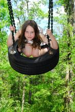 Cute Girl On Tire Swing