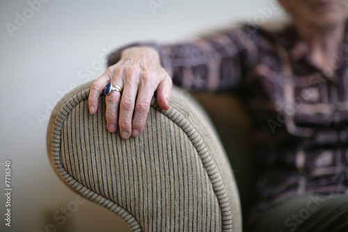 Senior woman hand on an armrest Wallpaper Mural