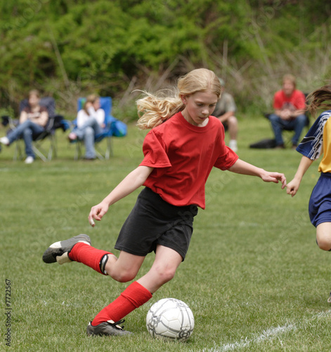 Photo  Youth Teen Soccer Player on Field Ready to Kick Ball
