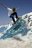 Skateboarder doing trick on ramp