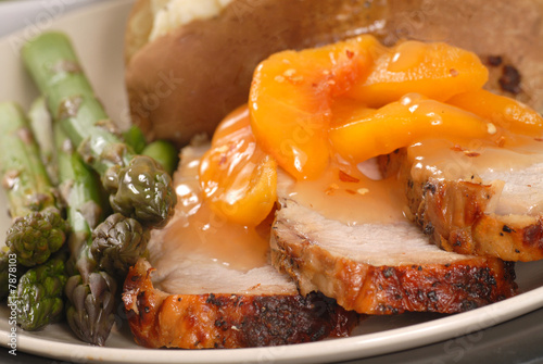 Valokuva  Grilled pork loin with peach sauce