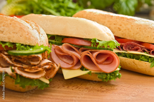 Staande foto Snack Ham sandwich, turkey sandwich and salami sandwich