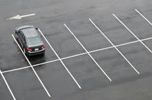 Single Car In Empty Parking Lot
