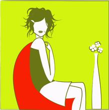 Jeune Fille Verte Dans Fauteuil Rouge