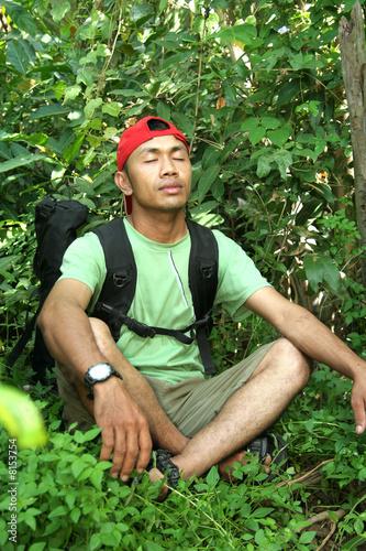 Valokuva  Hiking backpacker enjoy in the forest