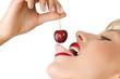 Leinwanddruck Bild licking cherry