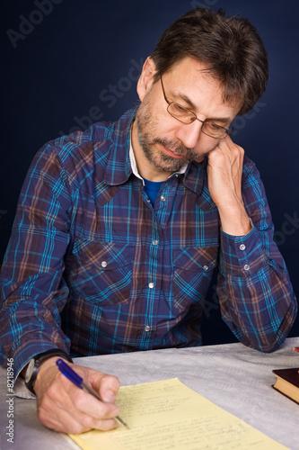 Valokuva  Researcher taking notes