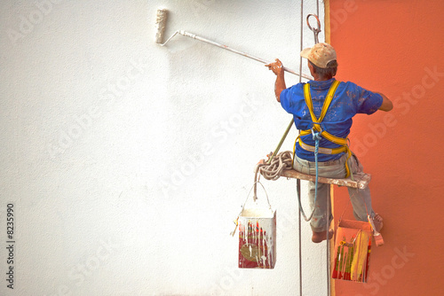Hanging Painter Painting Wall With Roller Buy This Stock Photo And