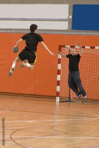 handball player jumping with the ball