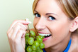 canvas print picture - Beautiful woman with green grape
