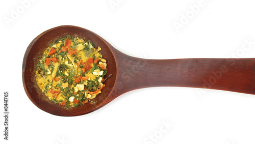 Photo  Vegetables and spices dried condiment in wooden spoon