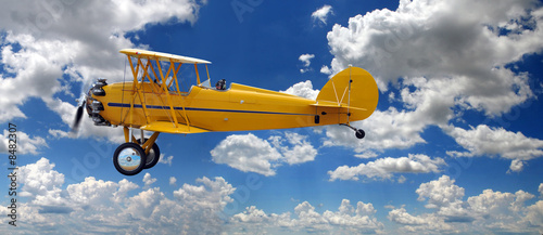 Vintage Biplane Over Clouds Canvas-taulu