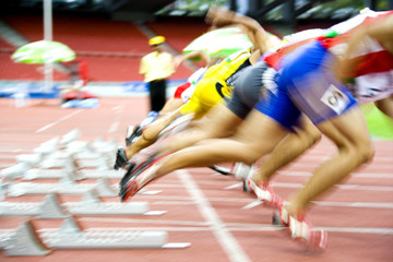 Fototapeta Athletes Starting with Motion Blur