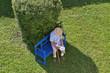 canvas print picture - Senior auf Gartenbank