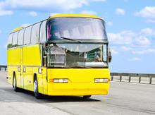 Yellow Bus On A Sunny Road