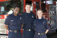 Portrait Of Firefighters Stand...