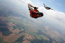 Skydiver Flies Past Cameraman