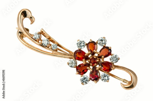 Golden brooch with garnet and  brilliants Fototapeta