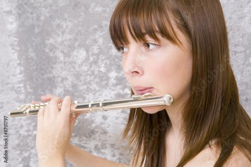 Fotografía Teenager girl playing flute