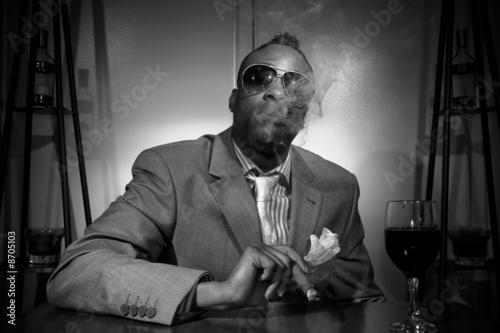 Slika na platnu a stylish african american smoking his cigar