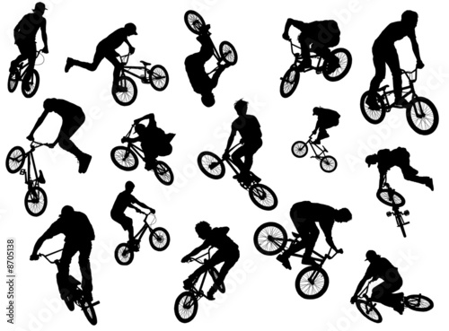 Black silhouettes of bmx and mtb riders Fototapete