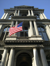 Historic Column Building With US Flag