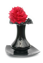 Rose In A Black Vase