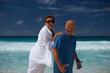 elderly couple having fun on the beach