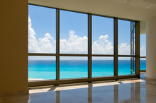 View Of Tropical Beach Through Hotel Windows