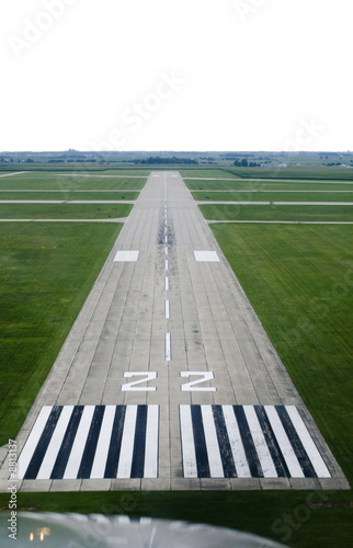Photo Looking down the runway of a rural airport.