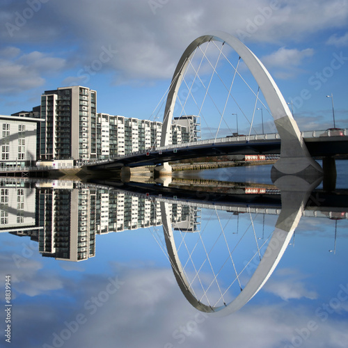 new bridge reflected in river Clyde Glasgow Scotland