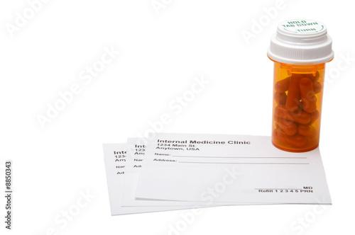 A medical prescription pad and prescribed pills. Canvas