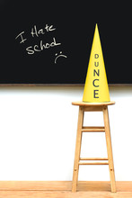 Yellow Dunce Hat On Stool With...