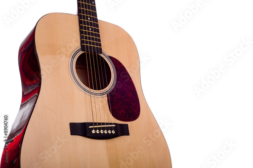 Photo A classic dreadnought guitar on a white background