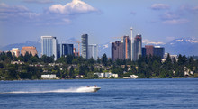 City Bellevue Lake Washington Speed Boat Snow Capped Mountains