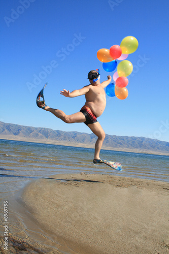 Valokuva  Happy absurdly Infantile businessman at vacation on sunny beach