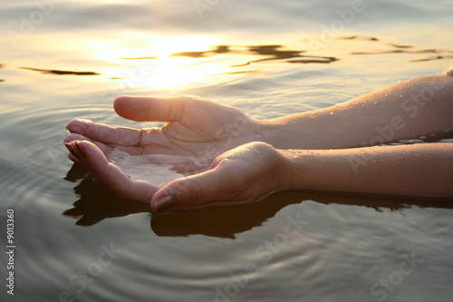 Vászonkép woman hands in water inviting you