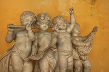 Statue Of 4 Little Angels Playing Musical Instruments