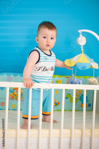 Baby Boy 1 Year Old Standing In Baby Bed At Children S Room