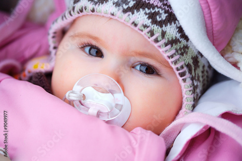 Fotografie, Obraz  2 months old baby outdoor in warm clothes, winter
