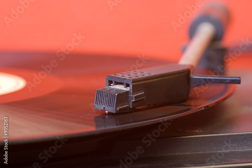Fotografering  vinyl record playing on a turntable..