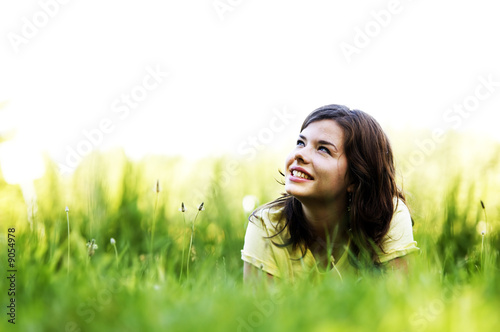 Fotografia  Pretty smiling girl relaxing outdoor