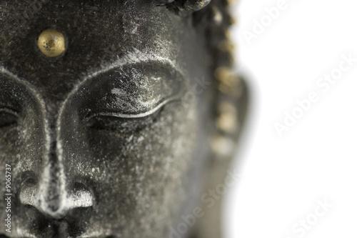 Fotografia statue de bouddha sur fond blanc