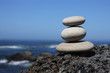 Pebbles stack on a volcanic rock near the sea