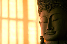 Buddha Statue Face With Sunlit Background.