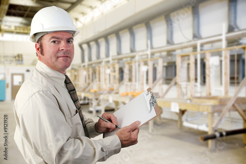 Fotografie, Obraz  Inpector performing an audit of a factory.