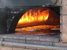 Pizza Prepares In Old Stove (oven) Near Fire